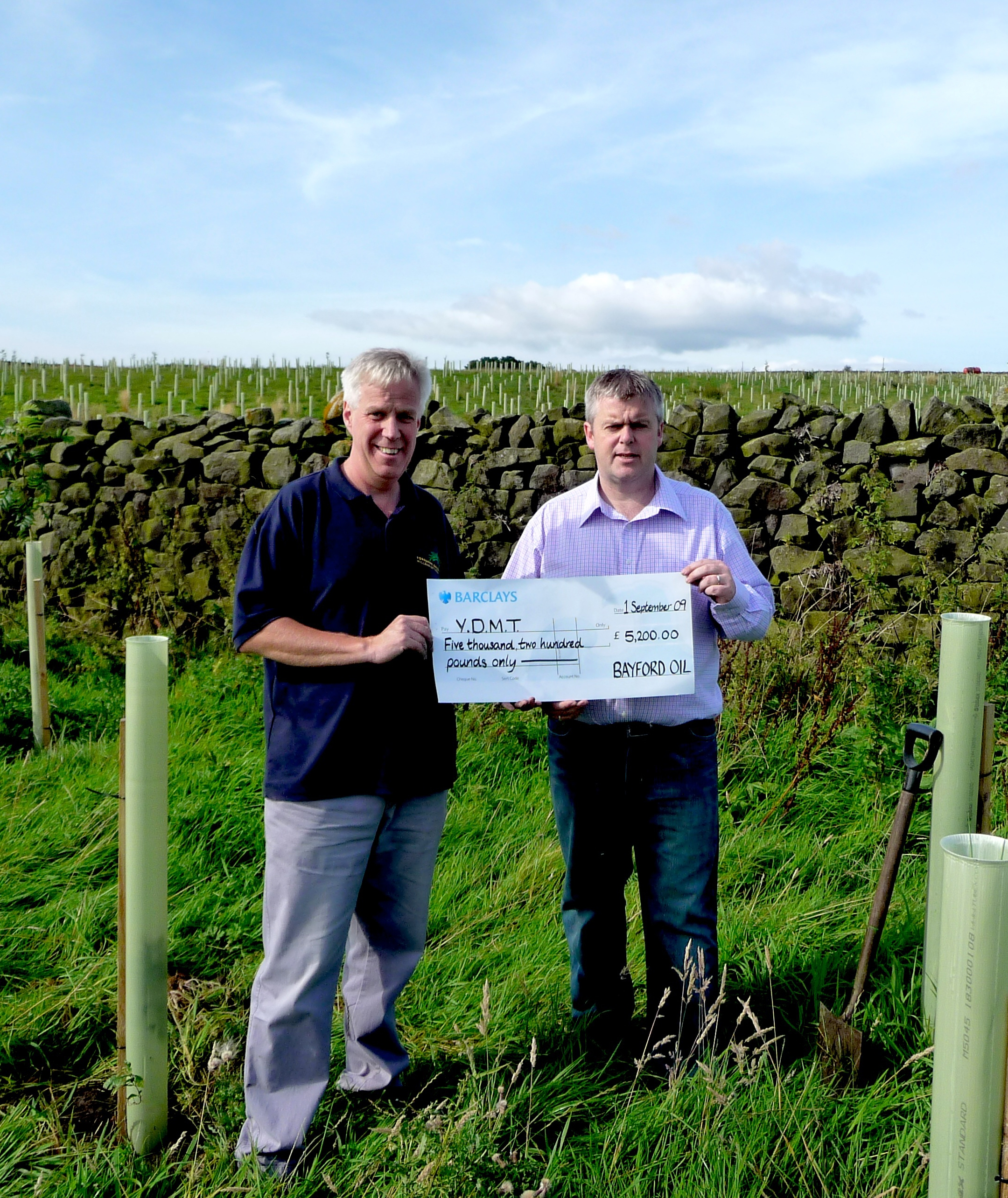 Rob Staines Director of Bayford (Right) presents giant cheque to our Director David Sharrod.
