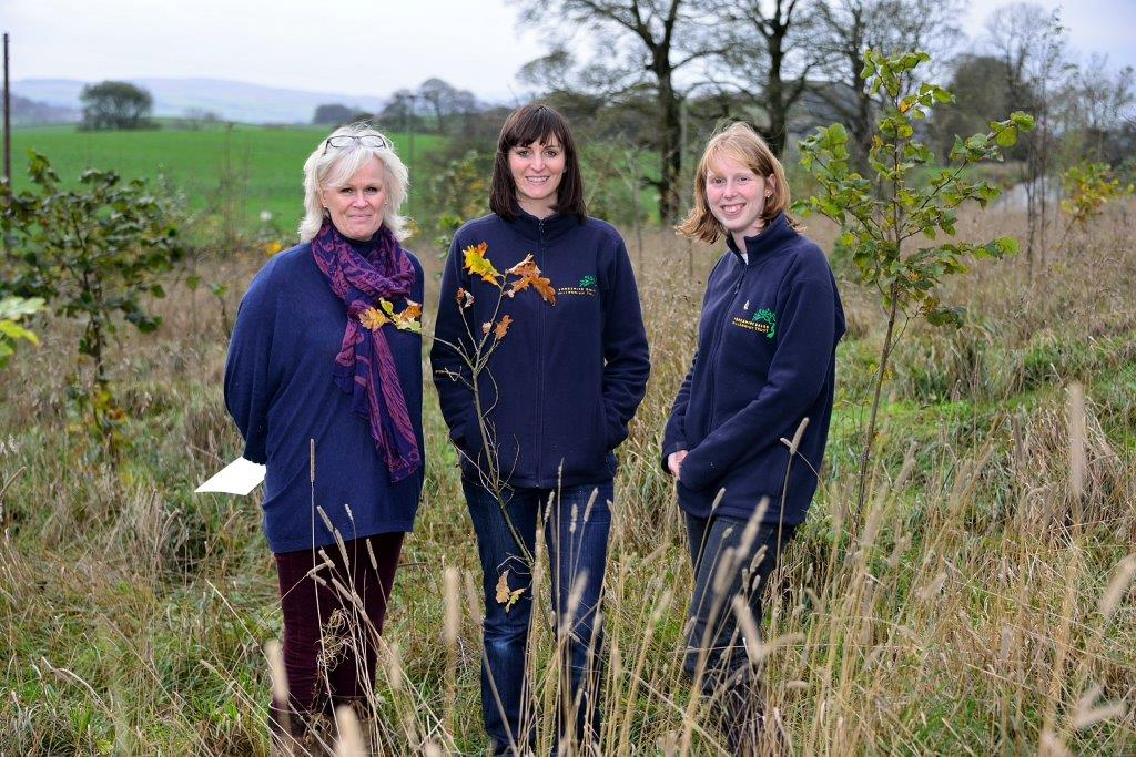 L-R: Liz Marshall from AIT with Lindsay Wallace and Sarah Brewer from YDMT at the new woodland
