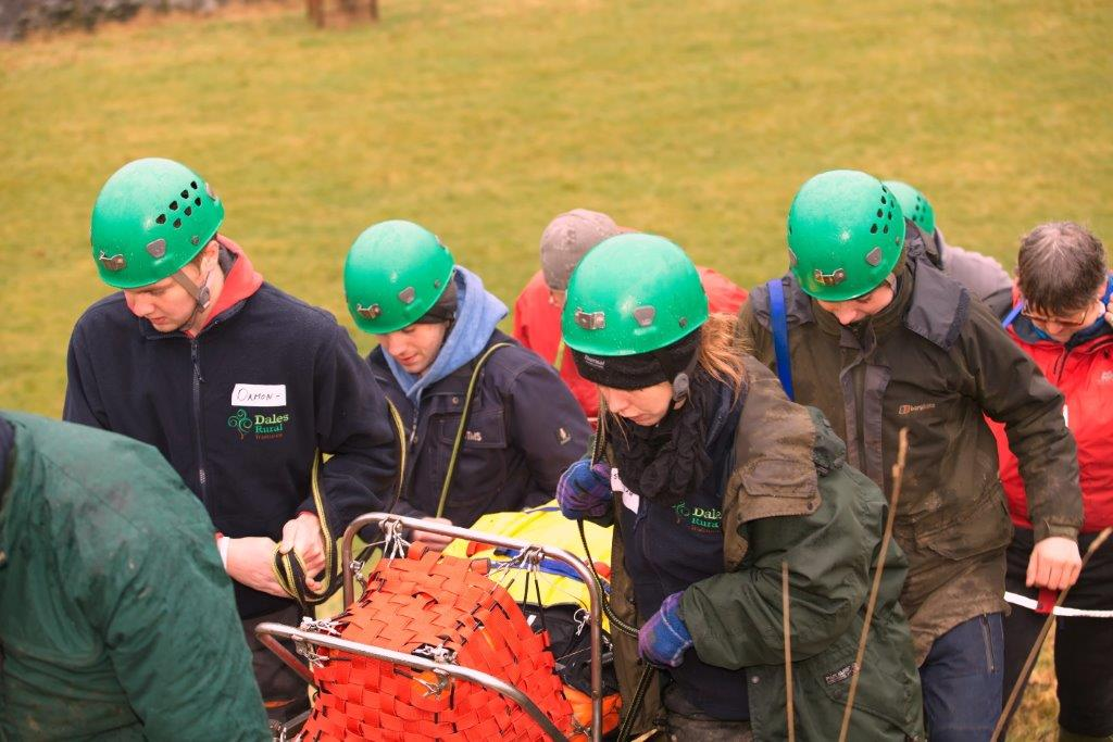 The trainees 'rescue' YDMT's Jo Boulter from a 'dangerous accident' by the riverside!